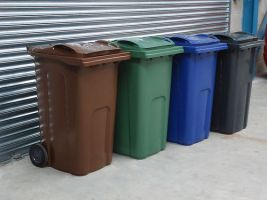 all wheelie bins in a row